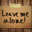 Note paper and clothes peg on wooden background with leave me — 图库照片 #27442451