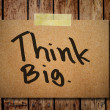 Note paper and clothes peg on wooden background with Think big — 图库照片 #27443001