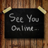 See you online on message note with wooden background — Stock Photo