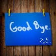 Good bye note paper and clothes peg on a wooden background with — Stock Photo