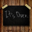 It's over on message note with wooden background — Stock Photo