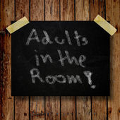 Adult in the room on message note with wooden background — Stock Photo