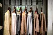 Tunics on on hangers — Stock Photo