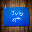 4th July and clothes peg on a wooden background — Stock Photo
