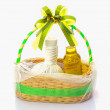 Stock Photo: Gift basket full of oli massage and aroma