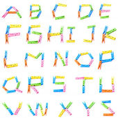 Cloth pins in ABC alphabet shape — Stock Photo