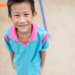 Asian boy enjoying at playground outdoor — Stock Photo