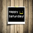 Stock Photo: Happy Saturday on grunge wooden background with copy space