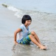 Adorable little girl playing at the beach — Stock Photo #33144895