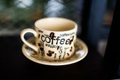 Coffee cup on wood background, Dept of fileld — Stock Photo