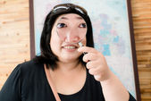 Funny woman face with magnifying glass — Stock Photo