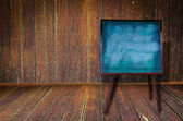 Photo of abstract grunge shabby interior with blackboard — Stock fotografie