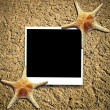 Black photo in beach sand with starfish. Vacation time!  — Stock Photo