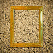 Blank gold wooden vintage frame on sand — Stock Photo