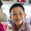 Portrait of a little smiling Asian boy in the car  — Stock Photo