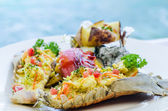 Mantis shrimp grilled with yellow herbal, baked potato — Foto Stock