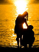 Couple on the beach with sun rise — Stock Photo