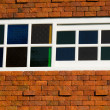 Brown wooden window on brick wall in sunny day — Stock Photo