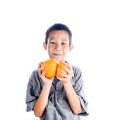 Happy Asian boy holding oranges in his hands — Stock Photo