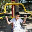 Asian boy play at gym outdoor in sunny day — Stock Photo