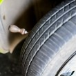 Metal plate in car tire  — Stock Photo