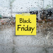 Black friday paper note on rain drop windows — Stock Photo