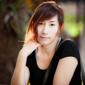 Beautiful Asian woman thinking in the park — ストック写真