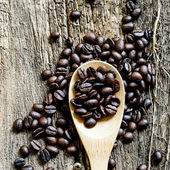 Coffee beans in wood surface, still life — Foto Stock