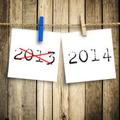 2014 message note paper attach to rope with clothes pins on wood — Stockfoto