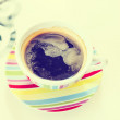 A cup of coffee on white table with retro filter effect — 图库照片