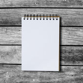 Black notebook on a wood background with clipping path — Stock Photo