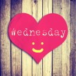 Love Wednesday on red heart shape with wooden wall — Stock Photo #37624539