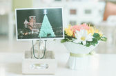 Flowers bouquet and christmas postcard with retro filter effect — Stock Photo