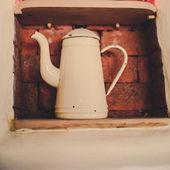 Yellow vintage metallic kettle — Stock Photo