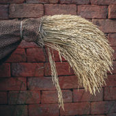 Uncooked organic rice in small burlap sack hanging on brick wall — Stock Photo
