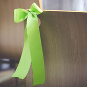 Green ribbon with wooden chair — Stock Photo
