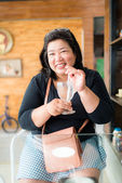 Happy fat business woman in coffee shop — Stock Photo