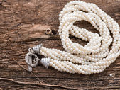 Pearl necklace on wood background with copy space — Stock Photo