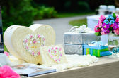 Sweet gift box heart shape on table for wedding day. — Stock Photo