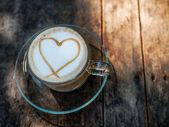 Heart shape on creamy coffee with natural light. — Foto de Stock