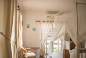 Warm tone in room with mosquito net. — Stock Photo