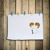 Boy kiss girl on with Clothes peg and paper notes with clipping — Stock Photo