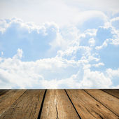 Wood floor with cloud and blue sky — Stock Photo