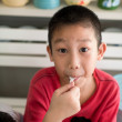Asian boy enjoy his chocolate icecream — Stock Photo #42856449