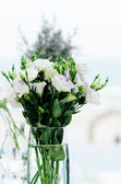 A floral wedding centerpiece on a table during a catered event — Stock Photo