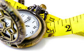 Pocket watch with Measure tape isolated on white, time limit con — Stock Photo