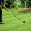 Player hit golf Stick and Ball on the Green Grass — Stock Photo #46314635