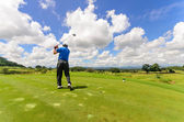 Golfer swinging his gear and hit the golf ball from tee to the f — Stock Photo