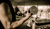 Fitness - powerful muscular man lifting weights  — Stock Photo