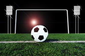 Soccer ball on green field — Stock Photo